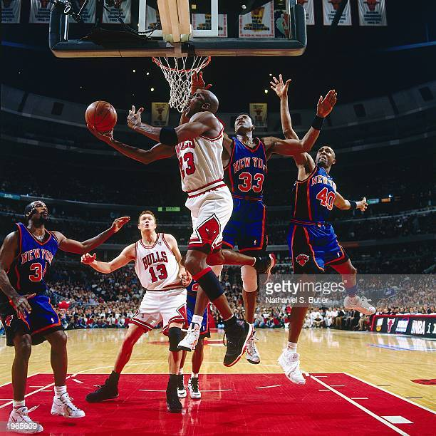 Michael Jordan of the Chicago Bulls takes a reverse layup against Patrick Ewing of the New York Knicks in Game five of the Eastern Conference...