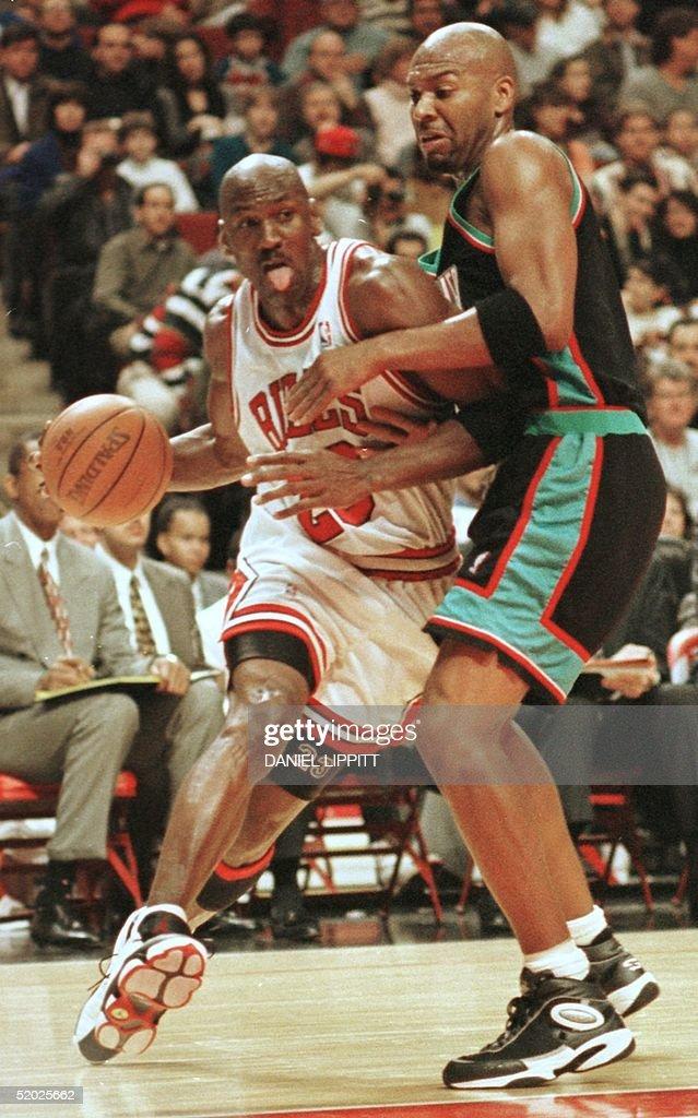 Michael Jordan (L) of the Chicago Bulls takes the : News Photo