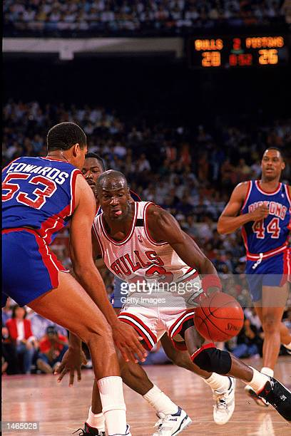 Michael Jordan of the Chicago Bulls takes the ball to the basket during the game against the Detroit Pistons. NOTE TO USER: It is expressly...