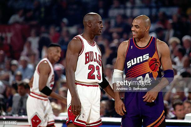 Michael Jordan of the Chicago Bulls talks to Charles Barkley of the Phoenix Suns during Game Five of the 1993 NBA Championship Finals at Chicago...