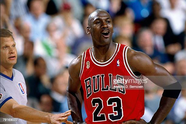 Michael Jordan of the Chicago Bulls talks to the referee in Game Three of the 1996 NBA Finals against the Seattle SuperSonics at Key Arena on June 9...
