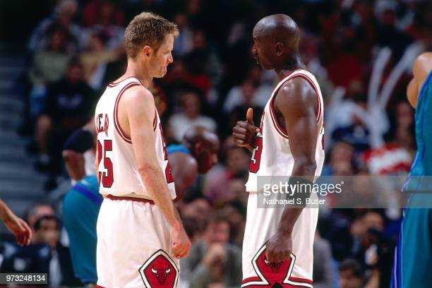 Michael Jordan of the Chicago Bulls talks to Steve Kerr of the Chicago Bulls during a game played on May 3 1998 at the United Center in Chicago...
