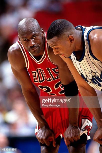 Michael Jordan of the Chicago Bulls talks with Anfernee Hardaway of the Orlando Magic during Game Four of the Eastern Conference Semifinals on May...