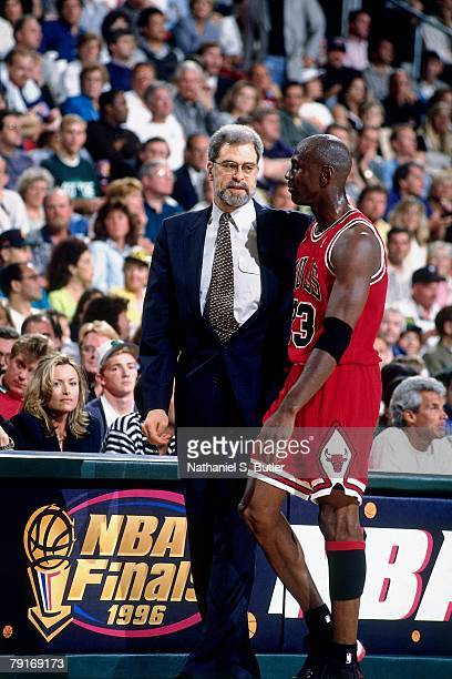 Michael Jordan of the Chicago Bulls talks with head coach Phil Jackson against the Seattle SuperSonics in Game Three of the 1996 NBA Finals at Key...