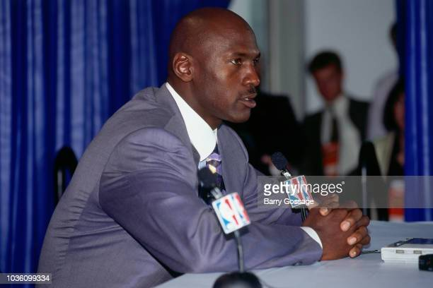 Michael Jordan of the Chicago Bulls talks with media at the post game interview after the game against the Utah Jazz on June 8 1997 at the Delta...