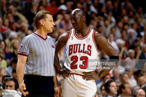Michael Jordan of the Chicago Bulls talks with referee in Game Two of the 1997 NBA Finals against the Utah Jazz at the United Center on June 2, 1997...