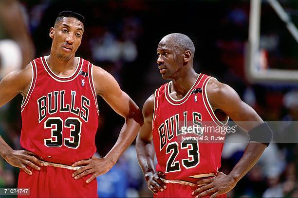 Michael Jordan of the Chicago Bulls talks with teammate Scottie Pippen during a game against the Philadelphia 76ers in 1992 at the Spectrum in...