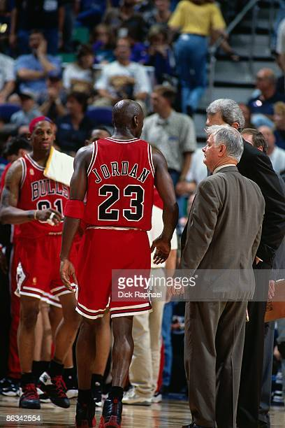 Michael Jordan of the Chicago Bulls talks with Tex Winter and head coach Phil Jackson at the bench during Game Five of the 1997 NBA Finals played...
