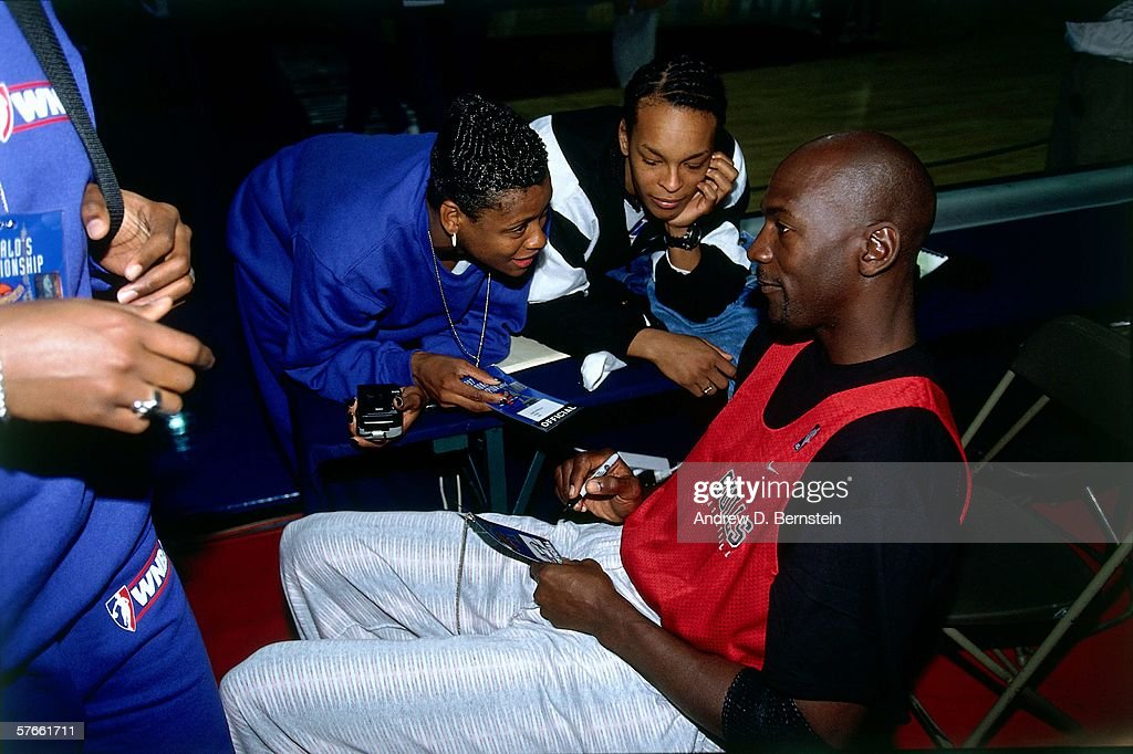 Michael Jordan of the Chicago Bulls talks with WNBA players during a ... 6a06e2efa4
