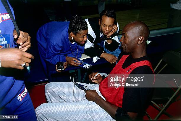 Michael Jordan of the Chicago Bulls talks with WNBA players during a Chicago Bulls practice prior to the 1997 McDonald's Championship played on...