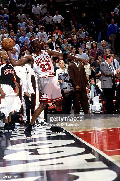 Michael Jordan of the Chicago Bulls throws a pass against the Utah Jazz in Game Five of the 1998 NBA Finals at the United Center on June 12 1998 in...