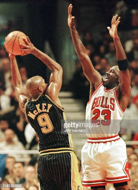 Michael Jordan of the Chicago Bulls tries to block the shot of Derrick McKey of the Indiana Pacers 19 May during the first half of game two of their...