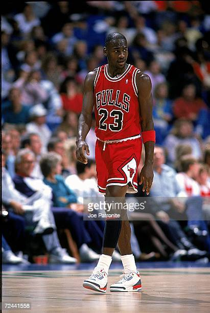 Michael Jordan of the Chicago Bulls walks and looks on from the court during the game Mandatory Credit Joe Patronite /Allsport
