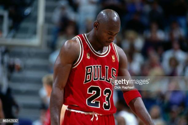 Michael Jordan of the Chicago Bulls walks off the court during Game Five of the 1997 NBA Finals played against the Utah Jazz on June 11 1997 at the...
