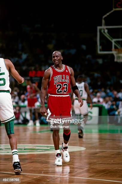 Michael Jordan of the Chicago Bulls walks up the court during a game against the Boston Celtics played at the Boston Garden in Boston Massachusetts...