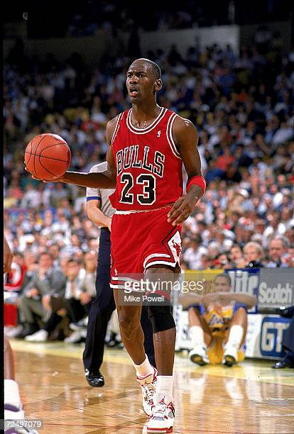 Michael Jordan of the Chicago Bulls with the ball during the game Mandatory Credit Mike Powell /Allsport