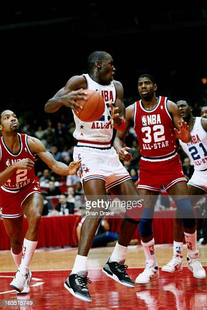 Michael Jordan of the East All Stars drives against Magic Johnson of the West All Stars during the 1992 NBA All Star game on February 12 1989 at the...