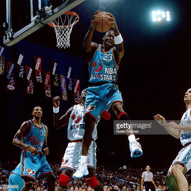 Michael Jordan of the Eastern Conference All Stars grabs the rebound against Dikembe Mutombo of the Western Conference All Stars during the 1996 NBA...