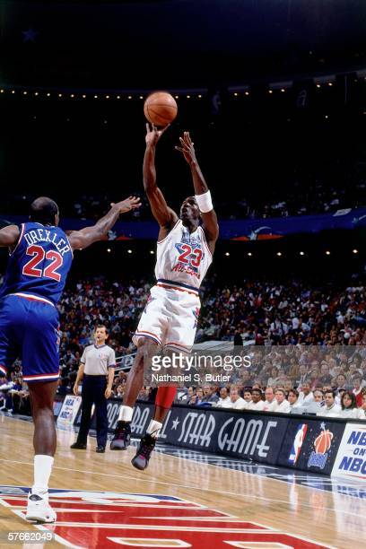 Michael Jordan of the Eastern Conference All Stars shoots a jump shot against Clyde Drexler of the Western Conference All Stars during the 1992 NBA...