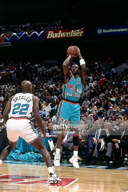 Michael Jordan of the Eastern Conference All Stars shoots a jump shot against Clyde Drexler of the Western Conference All Stars during the 1996 NBA...