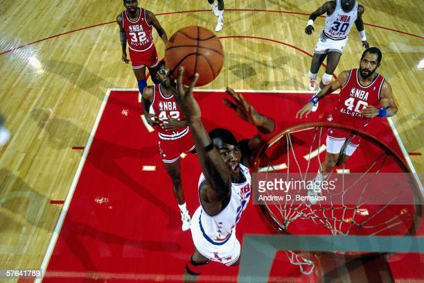 Michael Jordan of the Eastern Conference All Stars takes the ball to the basket against James Donaldson of the Western Conference All Stars during...
