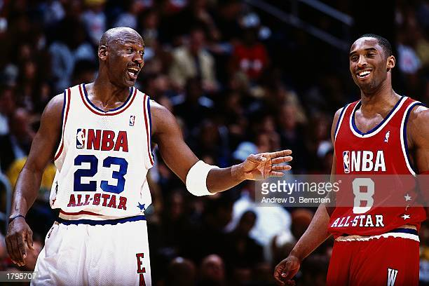 Michael Jordan of the Eastern Conference All Stars talks with Kobe Bryant of the Western Conference All Stars during the 2003 NBA AllStar Game at the...