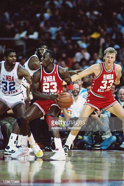 Michael Jordan of the Eastern Conference AllStars drives against Magic Johnson of the Western Conference AllStars on February 8 1987 at the King Dome...