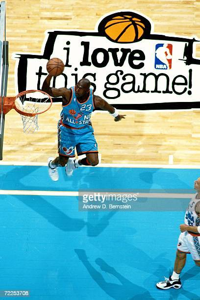 Michael Jordan of the Eastern Conference AllStars elevates for a dunk against the Western Conference AllStars during the 1996 NBA AllStar game played...