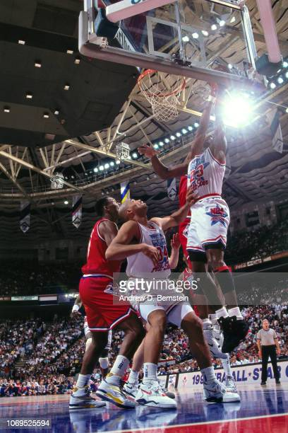 Michael Jordan of the Eastern Conference AllStars goes for the rebound against the Western Conference AllStars during the 1991 NBA AllStar game on...