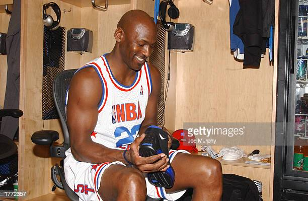 Michael Jordan of the Eastern Conference AllStars laces up his shoes prior to the 2003 NBA AllStar Game on February 9 2003 at Phillips Arena in...