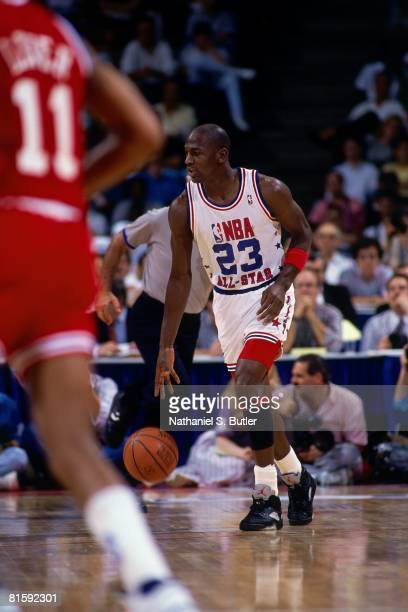 Michael Jordan of the Eastern Conference AllStars moves the ball up court against Lafayette Fat Lever of the Western Conference AllStars during the...