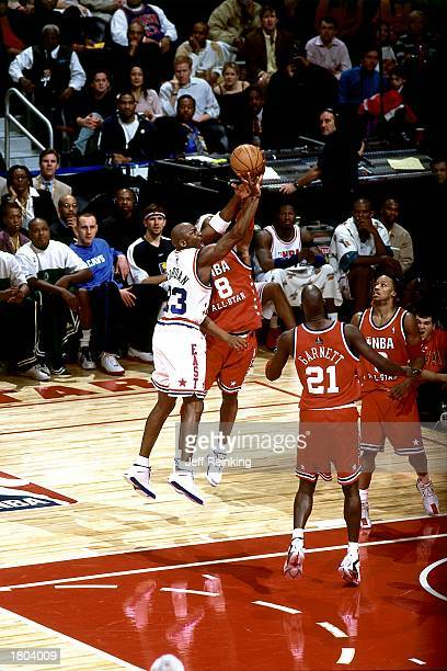 Michael Jordan of the Eastern Conference All-Stars puts up a shot against Kobe Bryant of the Western Conference during the 52nd NBA All-Star Game at...