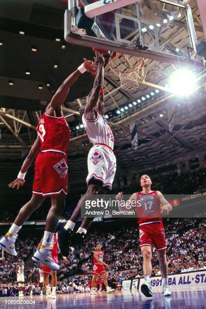 Michael Jordan of the Eastern Conference AllStars rebounds against Karl Malone of the Western Conference AllStars during the 1991 NBA AllStar game on...