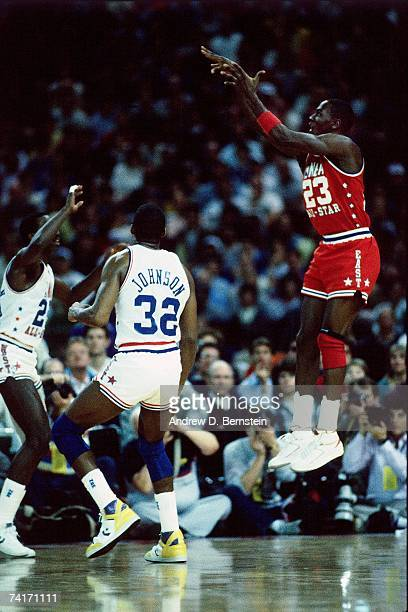 Michael Jordan of the Eastern Conference AllStars shoots a jump shot against Magic Johnson of the Western Conference AllStars during the 1987 NBA...