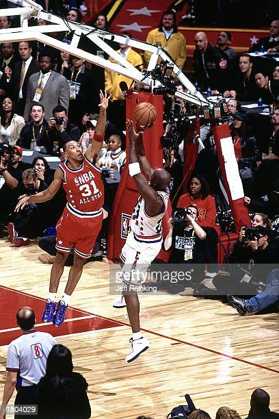 Michael Jordan of the Eastern Conference AllStars shoots a jumper against Shawn Marion of the Western Conference during the 52nd NBA AllStar Game at...