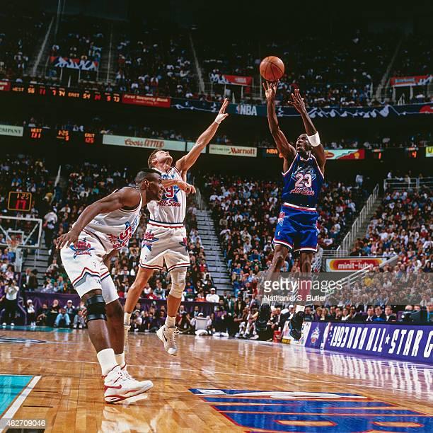Michael Jordan of the Eastern Conference AllStars shoots against Dan Majerle and David Robinson of the Western Conference AllStars during the 1993...