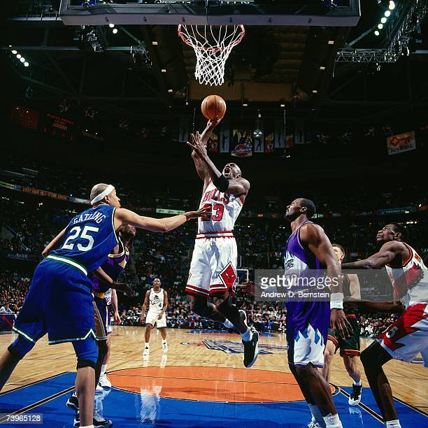 Michael Jordan of the Eastern Conference dunks against Chris Gatling of the Western Conference during the 1997 AllStar Game on February 9 1997 at...