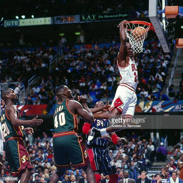 Michael Jordan of the Eastern Conference dunks against Shawn Kemp of the Western Conference during the 1997 AllStar Game on February 9 1997 at Gund...