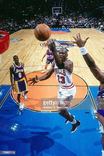 Michael Jordan of the Eastern Conference shoots against Eddie Jones of the Western Conference during the 1997 AllStar Game on February 9 1997 at Gund...