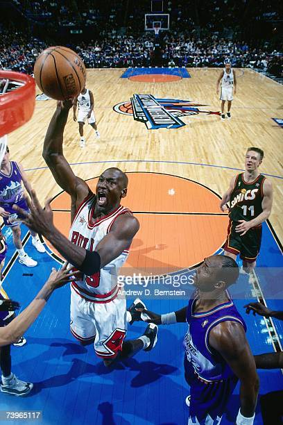 Michael Jordan of the Eastern Conference shoots against Karl Malone of the Western Conference during the 1997 AllStar Game on February 9 1997 at Gund...