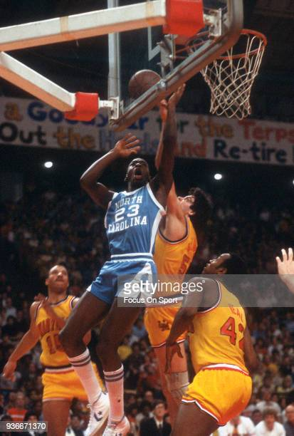Michael Jordan of the North Carolina Tar Heels goes in for a layup against the Maryland Terrapins during an NCAA basketball game January 6 1982 at...