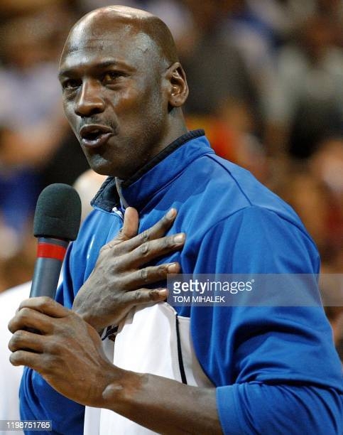 Michael Jordan of the Washington Wizards addresses fans during a ceremony in his honor prior to the last game of his NBA career 16 April 2003 against...