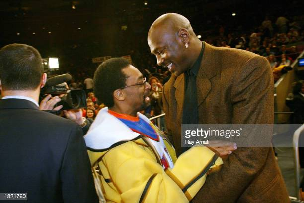 Michael Jordan of the Washington Wizards and Film Director Spike Lee are present for Patrick Ewing's jersey retirement during the New York Knicks and...