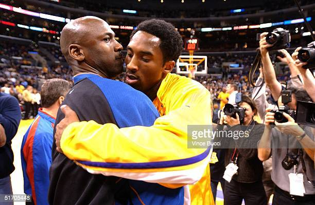 Michael Jordan of the Washington Wizards and Kobe Bryant of the Los Angeles Lakers embrace before the start of their 12 February 2002 game in Los...