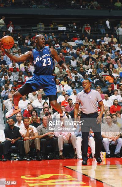 Michael Jordan of the Washington Wizards attempts to save the ball from going out of bounds during the game against the Atlanta Hawks at Philips...