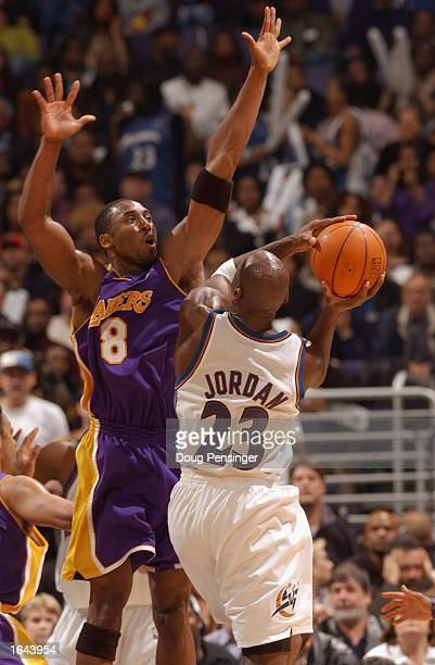 Michael Jordan of the Washington Wizards attempts to shoot the ball past Kobe Bryant of the Los Angeles Lakers during the game at MCI Center on...