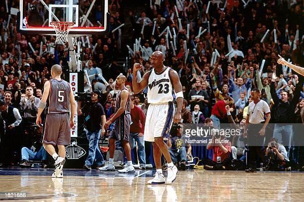 Michael Jordan of the Washington Wizards celebrates during the NBA game against the New Jersey Nets at the MCI Center on February 21 2003 in...