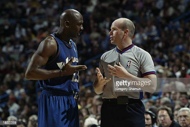 Michael Jordan of the Washington Wizards discusses the play with referee Gary Zielinski during the NBA game against the New Orleans Hornets at New...