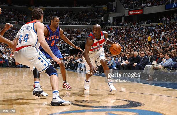 Michael Jordan of the Washington Wizards drives against Latrell Sprewell of the New York Knicks during the NBA game at MCI Center on April 14 2003 in...