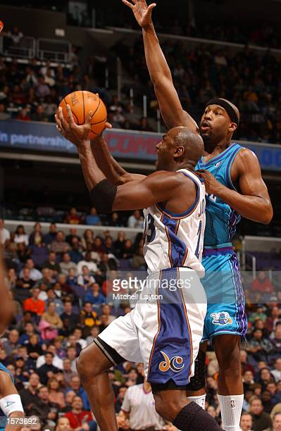 Michael Jordan of the Washington Wizards drives into the lane for a layup while Baron Davis of the Charlotte Hornets attempts to gaurd him at the MCI...